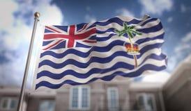 Rappresentazione della bandiera 3D di Territorio Britannico dell'Oceano Indiano sul cielo blu Bui Immagini Stock Libere da Diritti