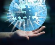Rappresentazione della sfera 3D di puzzle di volo della tenuta dell'uomo d'affari Fotografia Stock Libera da Diritti