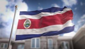 Rappresentazione di Costa Rica Flag 3D sul fondo della costruzione del cielo blu Immagine Stock Libera da Diritti