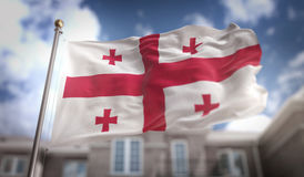 Rappresentazione di Georgia Flag Flag 3D sul fondo della costruzione del cielo blu Immagini Stock
