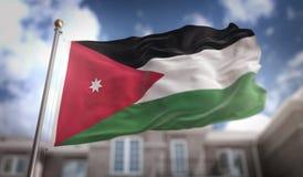 Rappresentazione di Jordan Flag 3D sul fondo della costruzione del cielo blu Fotografia Stock