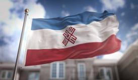 Rappresentazione di Mari El Flag 3D sul fondo della costruzione del cielo blu Fotografie Stock Libere da Diritti