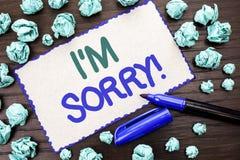 Rappresentazione I m. della nota di scrittura spiacente Montrare della foto di affari si scusa decreto doloroso pentito di scuse  fotografia stock