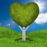 Rappresentazione umana che tiene un grande cuore verde Fotografie Stock