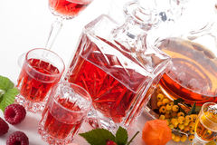 Rapsberry and rowanberry liqueurs Royalty Free Stock Photo
