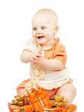Rapt baby with festive gifts Royalty Free Stock Photo