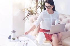Rapt in contemplation career lady working in office. So much work to do. Attractive woman of business absorbed in her thoughts looking at documents on a table Royalty Free Stock Photos