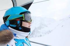 Rapt female skier rides on funicular royalty free stock image
