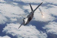 Raptor F-22. An F-22 Raptor aircraft deployed flares stock image