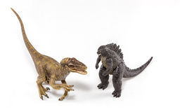 Raptor and Godzilla Fighting royalty free stock images