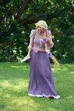 Rapunzel. Female entertainer dressed up as the Disney princess Rapunzel in a park; February 2014 Stock Photo