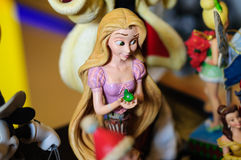 Rapunzel Figurine. On a sophisticated figurine, toy, comic, board game and collection shop Stock Photos