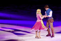 Rapunzel and Flynn dance during Disney on Ice. Rapunzel dances with flyn during the second half of Disney on Ice Dare to Dream Royalty Free Stock Image