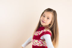 Rapunzel-like little Girl, Posing in Knitted Dress Royalty Free Stock Photo