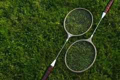 Raquet set on green grass Royalty Free Stock Image