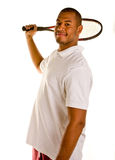 Raqueta de Tennsi del hombre negro detrás de la vertical principal Fotografía de archivo
