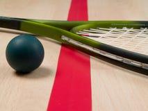 Raqueta y bola de calabaza Imágenes de archivo libres de regalías