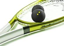 Raquete e bolas verdes e de prata de polpa Imagens de Stock