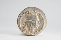 Rare Ancient Coin. Obverse of ancient silver coin on light gray background Royalty Free Stock Image