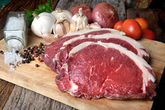 Rare Angus beef cut and ready for cooking stock images