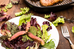 Rare beef and lettuce on a plate Royalty Free Stock Image