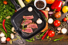 Rare Beef Slices in Pan Surrounded by Ingredients Royalty Free Stock Photo