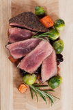 Rare beef steak with carrot and brussel sprout Stock Photography
