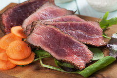 Rare beef steak with carrot and fresh salad Royalty Free Stock Photography