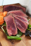Rare beef steak with carrot and fresh salad Royalty Free Stock Photos