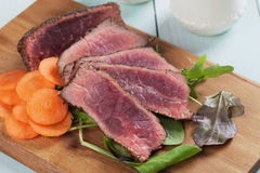 Rare beef steak with carrot and green salad Stock Photos