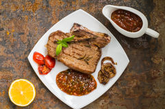 Rare Beef steak medium grilled with barbecue sauce. Old table. Top view. Close-up Stock Images