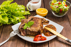 Rare Beef steak medium grilled with barbecue sauce. Wooden table. Top view Royalty Free Stock Images