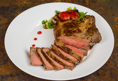 Rare Beef steak medium grilled with barbecue sauce. Wooden table. Top view. Close-up. Rare Beef steak medium grilled with barbecue sauce. Wooden table. Top view Royalty Free Stock Photo