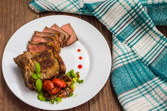 Rare Beef steak medium grilled with barbecue sauce. Wooden table. Top view. Close-up. Rare Beef steak medium grilled with barbecue sauce. Wooden table. Top view Stock Photo