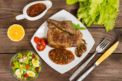 Rare Beef steak medium grilled with barbecue sauce. Wooden table. Top view Stock Photo