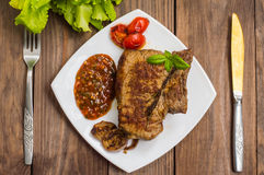 Rare Beef steak medium grilled with barbecue sauce. Wooden table. Top view. Close-up Stock Photo