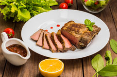 Rare Beef steak medium grilled with barbecue sauce. Wooden table. Top view. Close-up. Rare Beef steak medium grilled with barbecue sauce. Wooden table. Top view Royalty Free Stock Photos