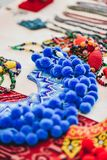 A rare handmade blue marik empang, part of native Iban traditional costume. A blue colour beadwork known as `marik empang`, a very popular traditional accessory Royalty Free Stock Image