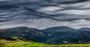 Rare cloud formation over mountains Royalty Free Stock Images