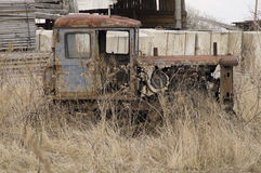 Rare crawler tractor cultivator stands abandoned in the grass Stock Photography