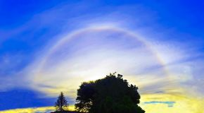 A rare 22 degrees sun halo royalty free stock photos