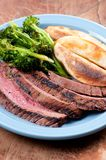 Rare flank steak. With potato wedges and brocolli Royalty Free Stock Images