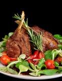 Rare fried rack of lamb isolated on black Royalty Free Stock Image
