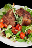 Rare fried rack of lamb isolated on black Stock Photos
