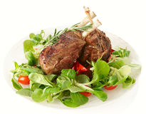 Rare fried rack of lamb isolated on white Royalty Free Stock Photography