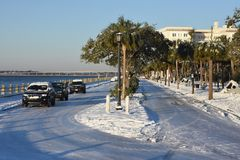 Murray Boulevard, Charleston, SC. After a rare January snowstorm in Charleston, SC, Murray Boulevard is covered in packed snow and ice.  Photo taken January 4 Stock Images