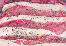Raw/Rare Steak/meat. Closeup shot of Raw/rare meat with seasoning Stock Images