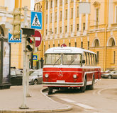 Rare Old Public Transport Vehicles. The ancient Soviet bus of red color in the street St. Petersburg Royalty Free Stock Photo