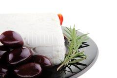 Rare olives and feta cube Royalty Free Stock Photos