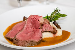 Rare Prime Rib with Potatoes and Rosemary Stock Image